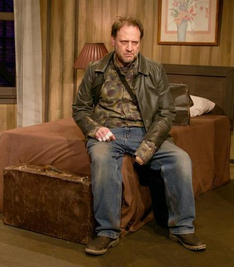 Gordon Carpenter is Carmichael in Theater Schmeater's production of A BEHANDING IN SPOKANE. Image by Dave Hastings.