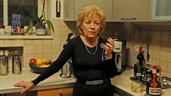 Motherlove and corruption. Luminiţa Gheorghiu takes a smoke break in Călin Peter Netzer's Child's Pose.